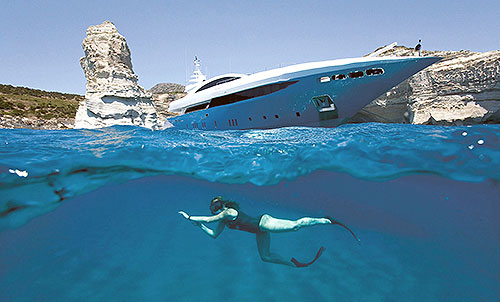 Adventure on the sea - Diving under a luxury yacht